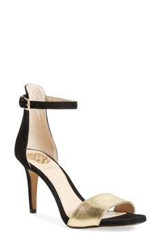 A slim ankle strap lends a dash of on-trend elegance to a clean and simplified high-heel sandal in black and gold.