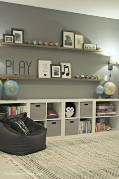 HUGE empty wall transformed into pretty game and toy storage! - HUGE empty wall transformed into pretty game and toy storage! This DIY toy storage idea is a kids playroom dream! Space for all the kids toys, books, blocks and everything else! Ikea Toy Storage, Game Storage, Bedroom Storage, Record Storage, Playroom Design, Playroom Decor, Playroom Ideas, Kid Playroom, Basement Ideas