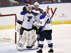CrowdCam Hot Shot: St. Louis Blues goalie Brian Elliott is congratulated by defenseman Roman Polak and defenseman Ian Cole after a 4-0 win over the Florida Panthers at BB