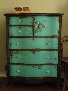 vintage dresser. Thinking black with teal drawers.