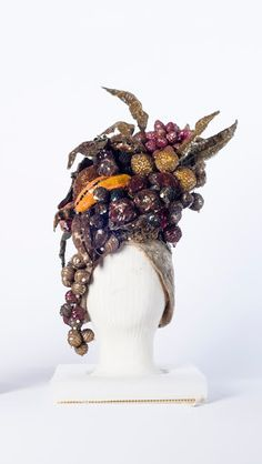 Turban embroidered with pearly sequins worn by Carmen Miranda. Topped by fruit basket embroidered with sequins and beads. Among the fruits: pineapple, bana...