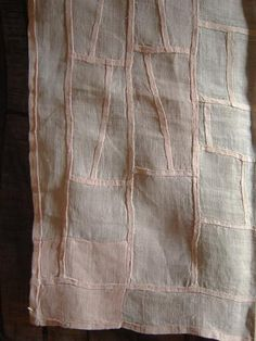 subtle design on Korean pojagi (hand stiched wrapping cloth sewn from scraps of rami and hemp)- (threads.srithreads)
