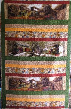 """A wonderful quilt for any lovers of trains, railroads, antique trains and miniature railroads.  This one is extra large measuring 45""""x72"""".  Don't miss out on this one.  Every family has a history buff and this is the perfect gift for that special person."""