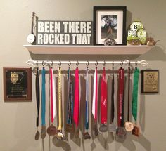 for sure doing this in my room for all my medals! Trophy Display, Award Display, Trophy Shelf, Display Wall, Race Medal Displays, Display Medals, Boy Room, Kids Room, Medal Holders