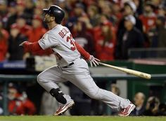 St. Louis Cardinals' Daniel Descalso watches his solo home run in the eighth inning of Game 5 of the National League division baseball series against the Washington Nationals on Friday, Oct. 12, 2012, in Washington.