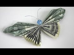 How to Make a Money Butterfly - Origami Dollar Bill. Heres how to make an origami dollar bill currency butterfly. Get fancy by adding a bead for the head. This project is complete with antennae. Enjoy this fun Classy Cheapskate video tutorial. Dollar Origami, Money Origami, Origami Boxes, Origami Folding, Origami Paper, Money Lei, Origami Gifts, Oragami, Origami Butterfly Instructions