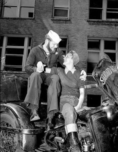 A biker girl and her sailor, c. 1940's.  Could sailors have beards?!