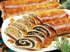 Bejgli (say: bey-glee) fine pastry rolls filled with poppy seed or walnut. Traditional Christmas dessert in Hungary. Hungarian Cuisine, Hungarian Recipes, Hungarian Food, Traditional Christmas Desserts, Good Food, Yummy Food, Polish Recipes, Polish Food, Pastry Cake
