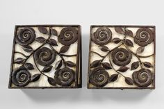 Edgar Brandt A PAIR OF ART DECO WROUGHT IRON AND ALABASTER WALL LIGHTS the rectangular face with floral and foliate decoration, with tapering sides Quantity: 2 each stamped 'E.BRANDT' to lower edge 33.5cm square by 11.5cm. deep max.; 13¼in., 4½in. circa 1925