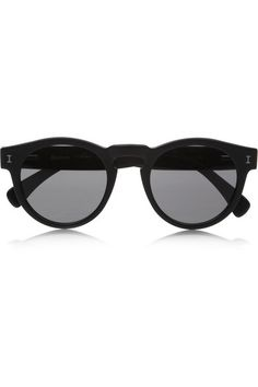 Illesteva's round-frame 'Leonard' sunglasses have been handmade in France. This black acetate pair is stamped with contrasting silver 'I' motifs and comes in a cool leather hard case. Shop it now at NET-A-PORTER