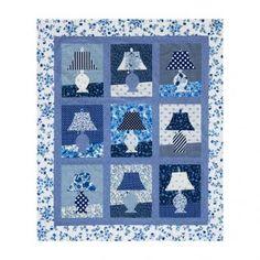 Make a two-color wall quilt featuring lamp-shape appliqué pieces.
