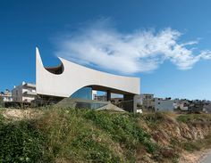 carefully studying the sun's path, the dwelling responds to the various angles of light and views to sculpt a sinuous concrete form that casts a play of light and shadow.
