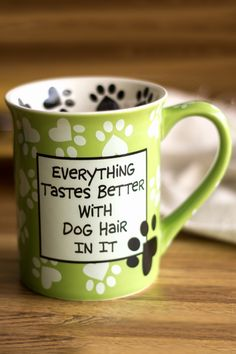 Dog lovers everywhere share a hairy secret . . . doggy fur gets into everything. Fortunately, our comical mug has the answer: don't despair, embrace the hair!  Designed by New York potter Lorrie Veasey.