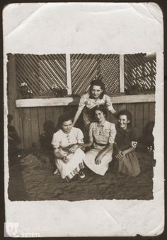 Four girls who are members of the Hanoar Hatzioni Zionist youth movement in the Sosnowiec ghetto