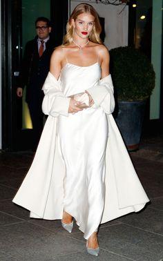Rosie Huntington Whiteley in a white slip dress and long white coat