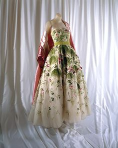 """""""May with stole"""" Design House: House of Dior (French, founded 1947) Designer: Christian Dior (French, Granville 1905–1957 Montecatini) Date: spring/summer 1953 Culture: French Medium: silk"""