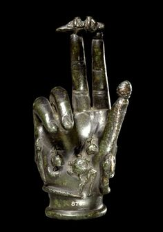 """Manopanthea. The upright-facing Hand of Power is generally considered to be benedictive in nature, but it also conveys magical protection to the household. When the hand is shown making the gesture known as the 'mano fico' (""""fig hand"""" in Italian), it acquires the apotropaic evil eye repelling quality of that gesture."""