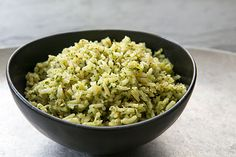 Mexican green rice, a rice pilaf cooked in chicken stock with poblano chiles, parsley, cilantro, onion, and garlic. Arroz verde.