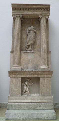 Altar of Athena Polias at Priene, reconstruction with original balustrade and relief with a Muse, 2nd century BC, Pergamon Museum Berlin.