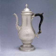 Thomas Shields, Philadelphia, PA, c.1775 - Coffee Pot of inverted baluster form on spreading gadrooned foot, S shaped scrolling spout, double scroll wood handle with shell below upper terminal,  bombé domed cover with gadrooned band & bud finial, engraved with a coat of arms within a foliate wreath & above a motto. The arms are those of Stockton for Richard Stockton (1730-1781), signer of the Declaration of Independence.