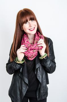 #rarr Sam shows off her wild side in a pink leopard print infinity scarf.
