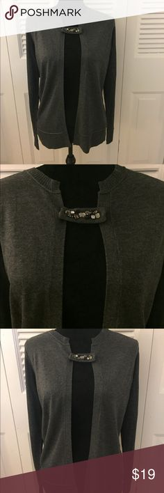 """Charcoal cardigan with embellished front tie. Charcoal cardigan with embellished, jeweled notch by Kristin Davis. Slits at bottom of cardigan. Long sleeves, elegant and soft. Bust 19"""" L 27"""". 60% Rayon 40% Acrylic. Size M. Kristin Davis Sweaters Cardigans"""