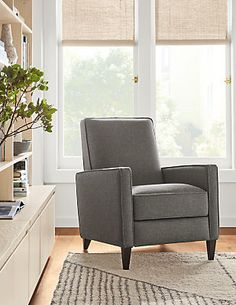 The Ellison recliner takes its inspiration from the elegantly tailored chairs of the 1950s. Narrow track arms, a thick plush seat and tapered legs take this chair from retro to refined. This lever-less recliner offers exceptional comfort and style in a compact size. Ellison is also available with an optional control panel on the inside of the right arm, which allows you to recline the chair with the push of a button. An adjacent USB port can be used to charge your devices.