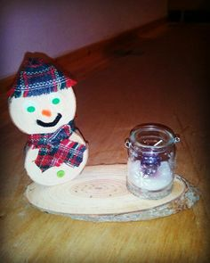 Wooden snowman with a candleholder