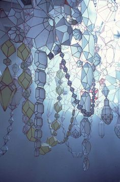 An abundance of translucent paper was used in Suite by Kirsten Hassenfeld. They were laboriously cut and glued together to form intricately designed polygons. Strung along together and draped from the ceiling, the stunning shapes create large strands of necklace-like paper sculptures.