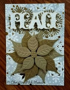 handmade Christmas card featuring Anna Griffin embossed die cuts ... PEACE and layered poinsettia ... non-traditional colors ...