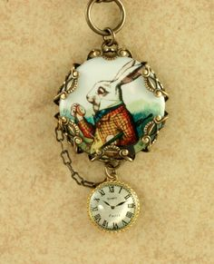 White Rabbit Necklace Alice in Wonderland Pocket Watch Brass Filigree Vintage Style Altered Art. $39.00, via Etsy.