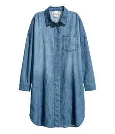 Denim blue. CONSCIOUS. Oversized shirt in soft, washed denim with concealed buttons at front. Dropped shoulders, long sleeves with buttons at cuffs, and a