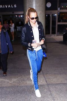 Style a sleek jacket with cool track pants and you're good to go just like Cara Delevingne