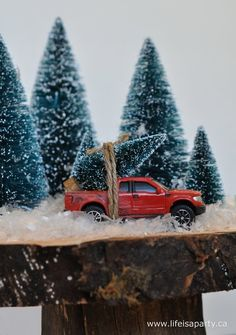 a-Christmas scene with truck and trees Oh my, have to do this with my village <3