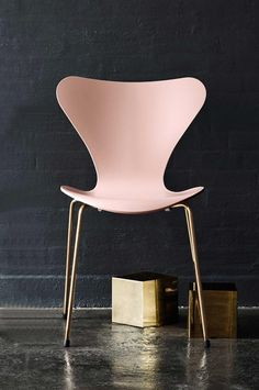 Fritz-Hansen-Anniversary-series-7-chair-oscial-edit -- Featuring a pale pink lacquer and 24-carat gold-plated legs, this iconic chair has a mounted gold plate on the back of the seat to mark it as a special edition piece.