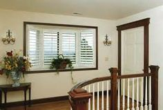 White Plantation Shutters With Dark Trim White