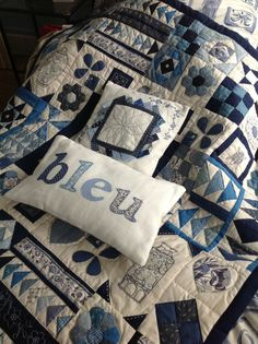 Like the idea of a sampler quilt in just shades of blue and teal against an ecru background! Lovely!