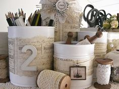 Old Tin Cans spray painted white with embelishments added. So very cute!