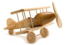 object op wit - houten speelgoed vliegtuig Stockfoto