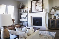 When adding art above a fireplace look at creating balance and harmony with side accents.