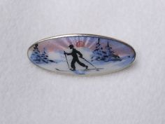 A NORWEGIAN 925S STERLING SILVER & ENAMEL SCENIC BROOCH BY NORNE