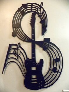 "Metal Wall Art Decor Guitar With Music Notes, Made Of High QualitySteel, Painted Black, In New Condition, Measures 25"" Wide By 40"" Tall, This is a very large piece and will be custom made to order so allow extra time for delivery. Please let us know if you would like it in a different color. We can customize it for you!"