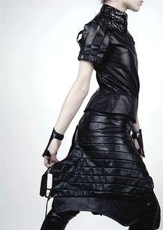 Ana Rajcevic: Black leather short sleeve coat, studio : ANA RAJCEVIC | FASHION, SCULPTURE AND BEYOND,