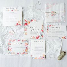 Beautiful wedding stationery in watercolor look, wrapped with our linen thread natural