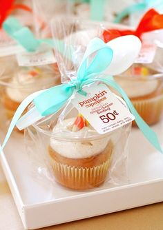 Love this cupcake packaging idea using 9oz tumbler cups.  I love the ribbon and the spoon.  Then a price tag for bake sale.  Or do a tag Happy birthday from..