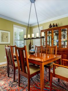 Formal dining room with modern light fixture, medium wood tones, neutral paint (not grey!) and hard wood flooring. This space is perfect for entertaining. Listed for $595,000 in Purcellville, Virginia by The Casey Samson Team is a Wall Street Journal Top Team in Northern Virginia.