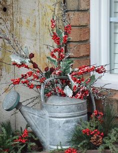 An old watering can is perfect for a Christmas outdoor arrangement.