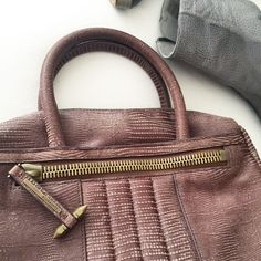 Item of the DayRally Bowling Bag-chocolate Slightly used bag but in great condition. almost like new. Missing straps. Brown croc pattern. Clean interior and exterior. Price is only for this weekend! All Saints Bags Crossbody Bags