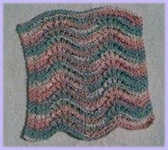 """Feather and Fan Dishcloth - I like the modified version better (just purl row 7 instead of knit) - makes a """"cleaner, neater"""" looking cloth"""