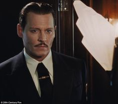 Mystery man: Johnny Depp is just one of the many stars in this fall's Murder On The Orient Express, playing murder victim Edward Ratchett